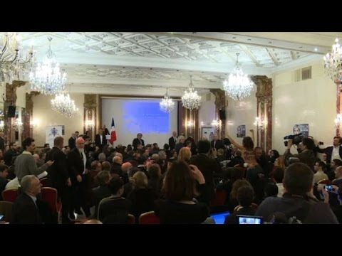 Marine Le Pen speech interrupted by Femen protester