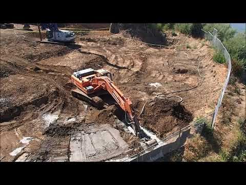 Soil mixing with excavator buckets for environmental remediation