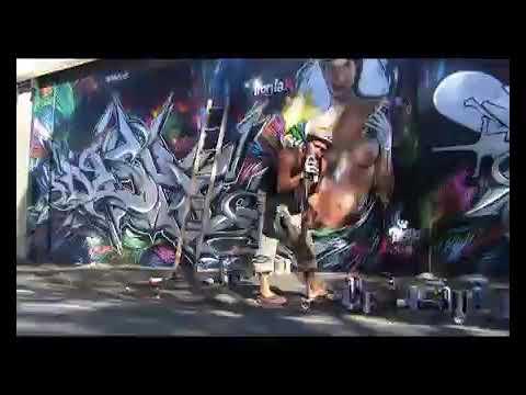 Dashe sprays Legend Pizza wall Byron Bay