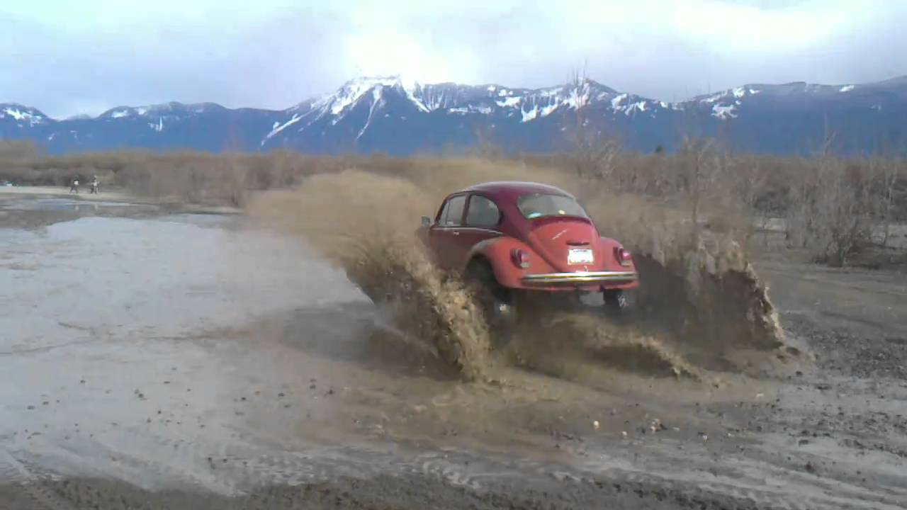 vw volkswagen beetle bug baja offroad in puddes on 35 inch tires and raised playing in puddes ...