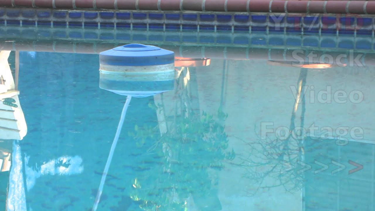 Floating chlorine dispenser for swimming pool chlorine tablets or liquid hd stock video for Chlorination of swimming pools