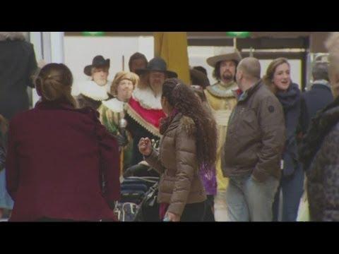 Dutch flashmob arrive at shopping mall on horses