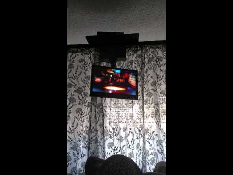 DIY canopy bed TV mount and curtains.