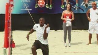 Usain Bolt plays footvolley in Rio de Janeiro