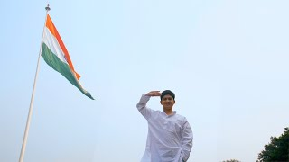 Indian teenager salutes at the Indian national flag - Republic/Independence Day