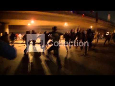 EGYPT: CAIRO CLASHES-RUNNING TEAR GAS