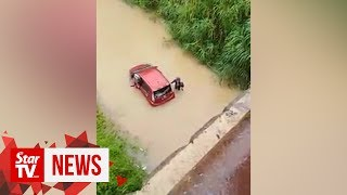 Doctor escapes death after car plunges into river