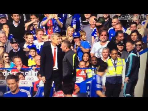 Arsene wenger pushes Jose mourinho