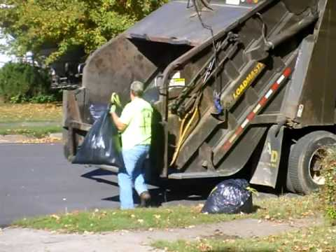 Garbage Truck Collecting 12 bags & Packing...