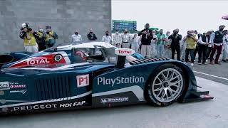 Carlos Tavares at the wheel of a PEUGEOT 908