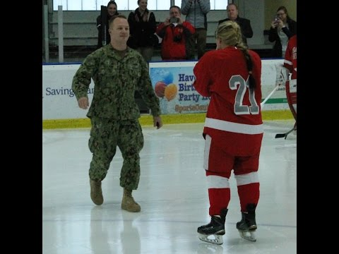 Teagan Ketchum, a senior from Averill Park, N.Y. on the Sacred Heart University women's ice hockey team, is surprised by her brother, Trevor, a member of the U.S. Navy, at Saturday's game.