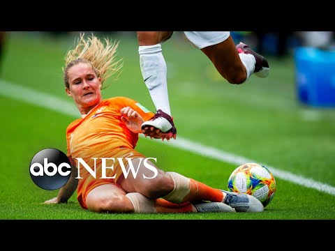 World in Photos, June 11: Women's World Cup, 'castellers' in Barcelona, a migrant