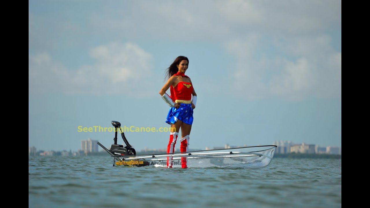 Wonder Woman In A Clear Kayak Canoe With Electric Motor