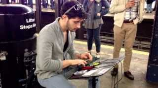 Breakbeat/Trip Hop in the subway. With an iPhone and mix pads.