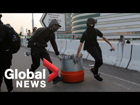 Hong Kong police deployed after protesters block roads, vandalize stores in Kowloon