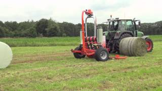 KUHN RW 1800 C Autoload & Autoswitch - Round bale wrappers (In action)