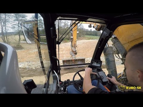 Liebherr A918 Whelled Excavator Pulling Slopes With Topsoil - Cab View