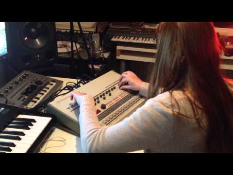 My girlfriend is programming the Roland TR-909, making a House beat