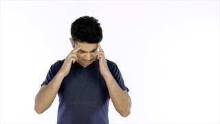 Stressed young man grabbing his head after listening to bad news - emotions concept
