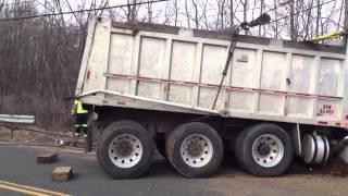 Triaxle Dump overturns