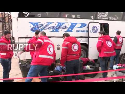 Syria: Buses transport opposition fighters and families from Homs