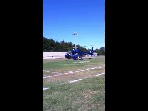 Helicopter landing at Millry High School.