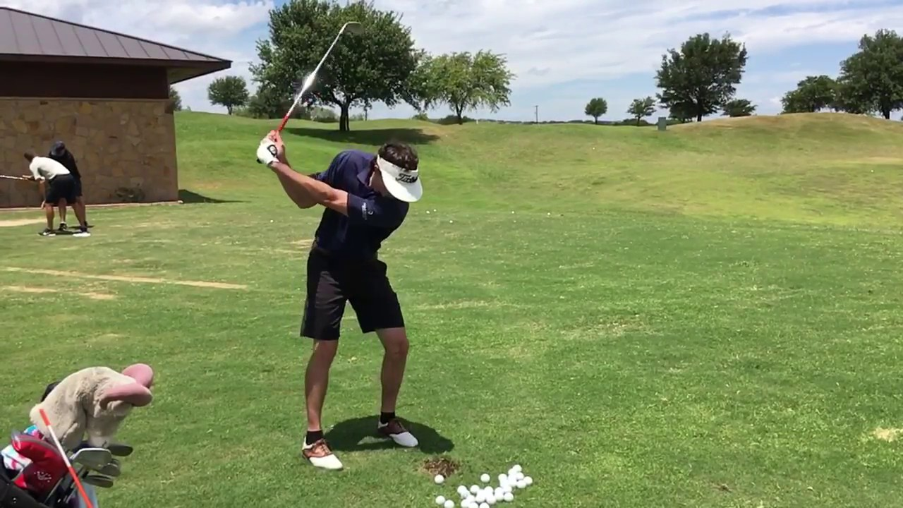 Working on getting the right arm in front on the downswing  Elite Golf Swing