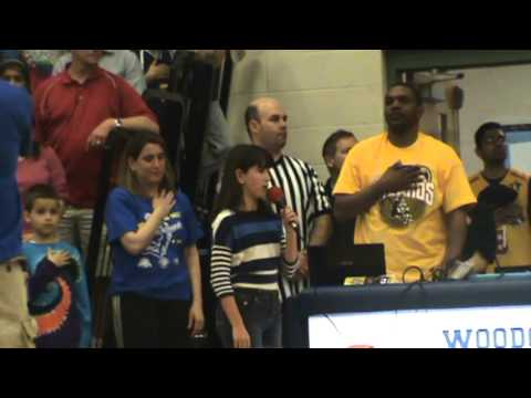 Erica singing the National Anthem at Harlem Wizards game at Woodcliff Middle School