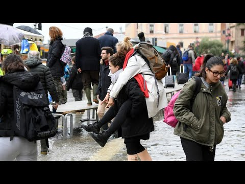 As rain batters Italy, Venice braces for high tide and another 'tough day'