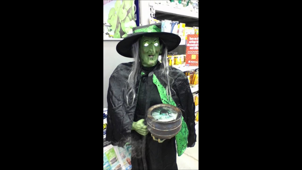 lowes 2012 gemmy witch holding misting cauldron - Lowes Halloween