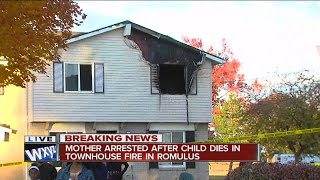 Child dies in townhouse fire in Romulus, mother arrested