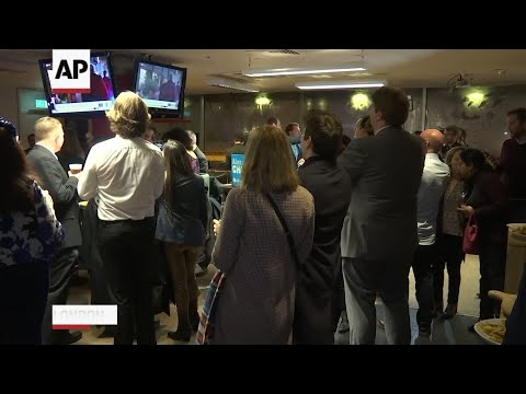 British ruling party supporters cheer exit poll