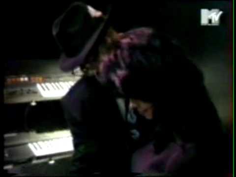 Janet Jackson playing the keyboard