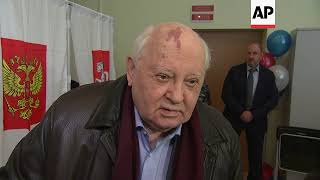 Ex-Soviet leader Gorbachev votes, comments on spy scandal
