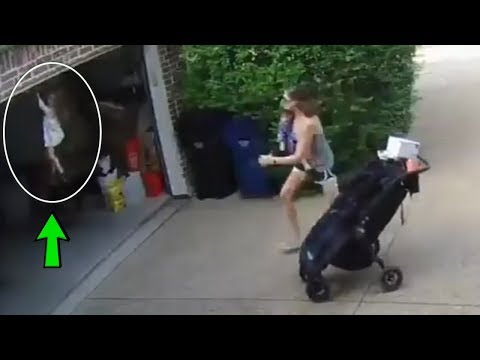 4 Yr Old Little Girl Grabs Hold Of A Rising Garage Door