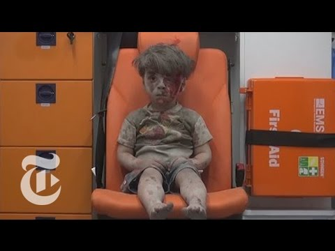 The Syrian Boy Pulled from the Rubble in Aleppo | The New York Times