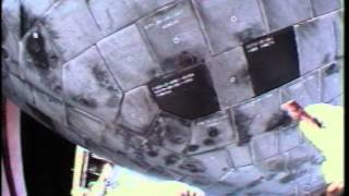Astronaut Steve Robinson Repairs Heat Shield