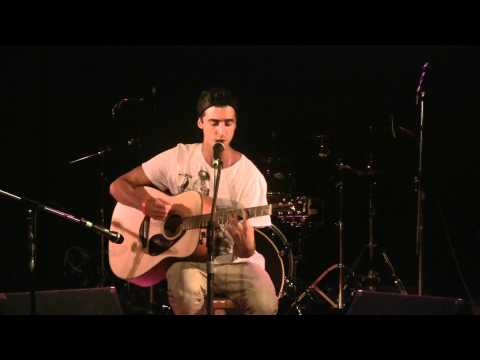 Acoustic guitar student performs at Guitar Workshop Plus