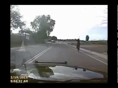 Officer Rams Armed Suspect