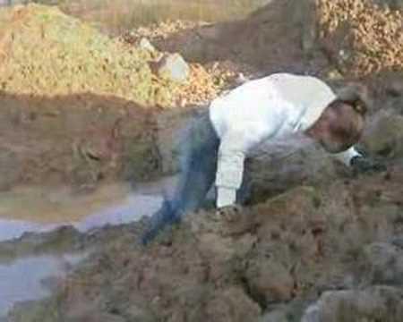 Blond girl gets stuck in very sticky mud