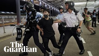 Hong Kong: airport protests descend into violence
