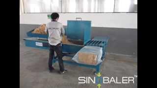 SINOBALER - Scale Weighing Horizontal Bagging Baler, a Baling and Bagging Machine.