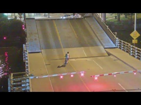 Woman rides bike onto bridge as it opens, falls through crack