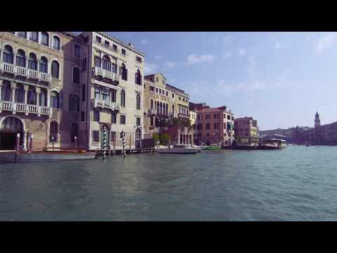 Tracking shot of waterside buildings on Grand Canal