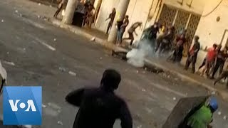 Protester Struck By Tear Gas Canister in Face in Iraq Protests