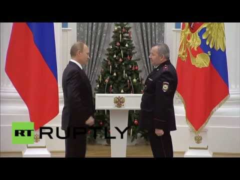 Russia: See Putin award policeman Russia's highest civilian decoration for defusing armed IED