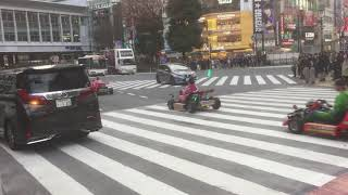 Pikachu vs Super Mario Bros vs Luigi across Shibuya crossing - Go kart battle