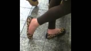 Feet shoeplay mature dipping at store Candid