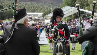 Kintore Pipe Band led by Drum Major Ronnie Rennie during the 2018 Braemar Gathering Highland Games