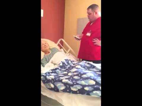 Hospice Worker Sings To Patient